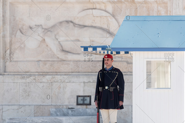 February 6, 2018: Traditionally dressed Greek soldier guards in front of the Unknow Soldier Tomb outside Parliament. Athens, Greece
