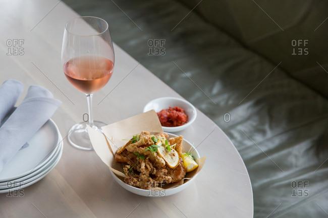 Calamari appetizer served with blush wine