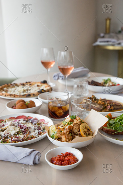 Variety of brunch dishes served with wine