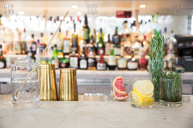Fresh herbs and citrus fruit on bar for cocktail garnishes