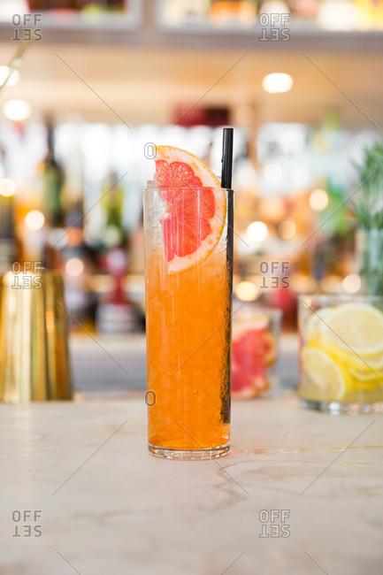 Orange citrus cocktail on a bar