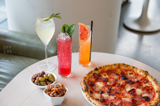 Variety of cocktails served with pizza
