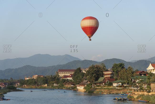 Hot air balloon flying over Vang Vieng, Laos