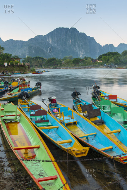 Vang Vieng, Laos - November 22, 2014: Colorful river boats at the shore of Nam Song River