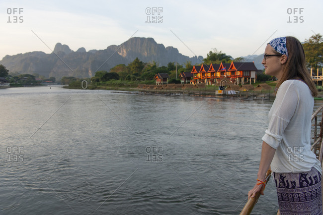 Female tourist gazing over Nam Song River in Vang Vieng, Laos