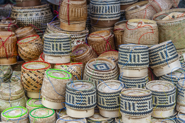 Rice containers on display at a market in Luang Prabang, Laos