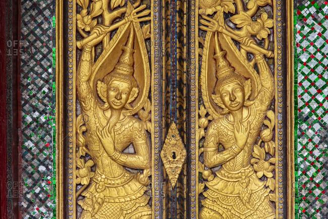 Detail of a temple door, Luang Prabang, Laos