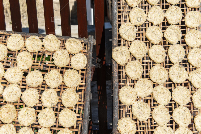 Handmade rice cakes drying in the sun in Luang Prabang, Laos