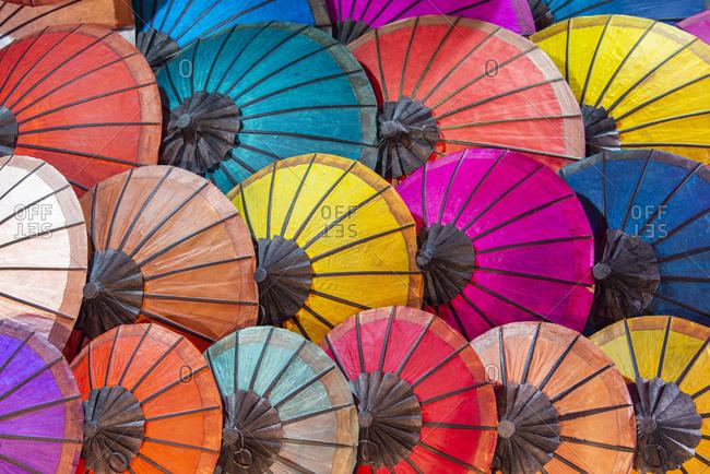 Colorful parasols on display at a night market in Luang Prabang, Laos