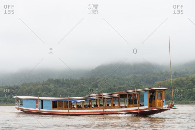 Luang Prabang, Laos - November 26, 2014: A river boat on the Mekong River