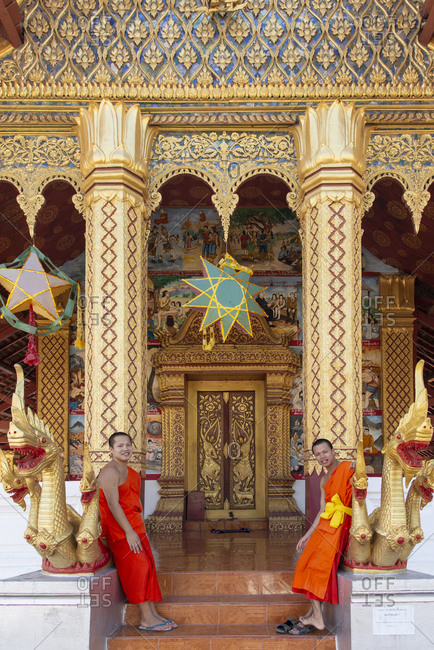 Luang Prabang, Laos - November 26, 2014: Monks at a Buddhist temple in Luang Prabang, Laos