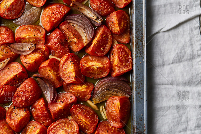 Close-up of roasted cherry tomatoes in a pan