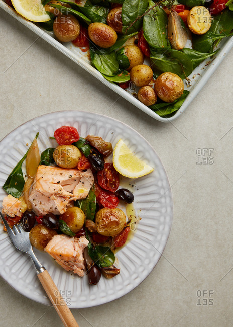 Serving of roasted salmon and vegetables for dinner