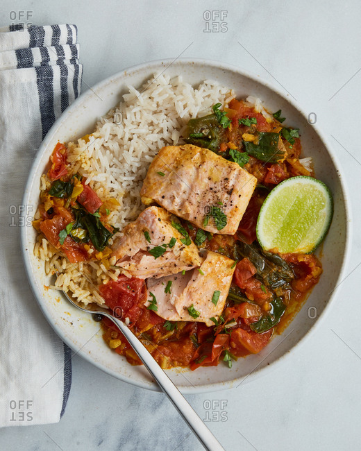 Dinner of baked salmon with rice and curry