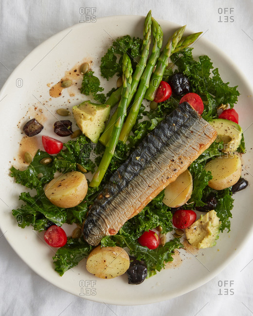 Baked mackerel and seasonal vegetables on a plate