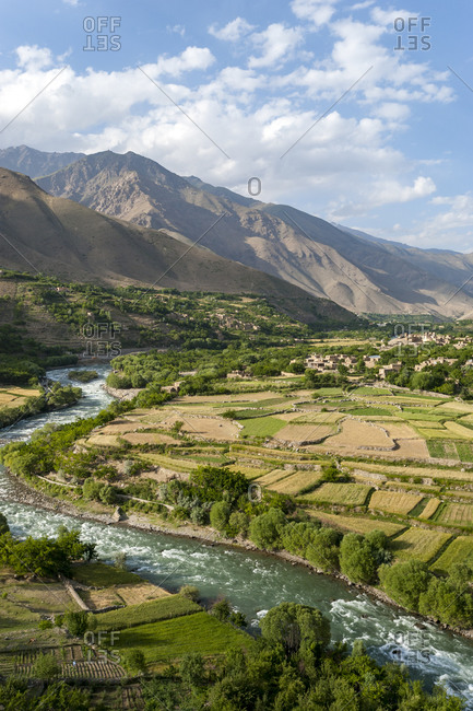 Green irrigated fields and contrasting arid hills above in the Panjshir Valley in Afghanistan