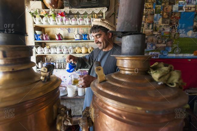 Istalif, Afghanistan - June 15, 2011: Man in tea shop