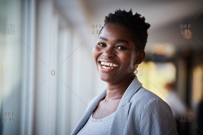 Portrait of confident female entrepreneur standing at workplace