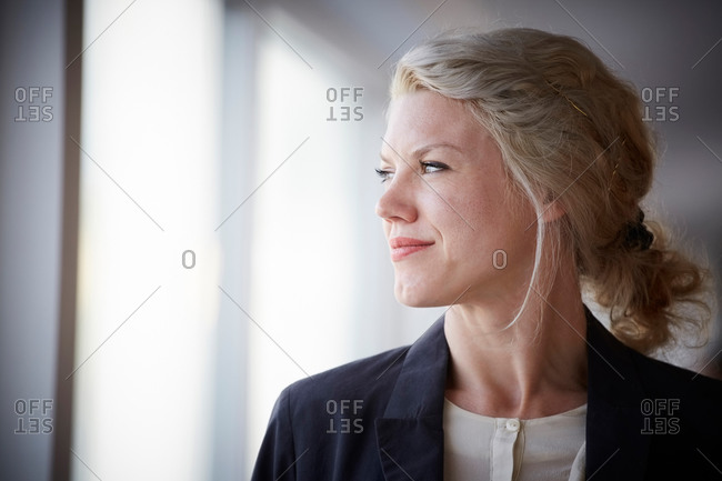 Confident businesswoman looking away at workplace