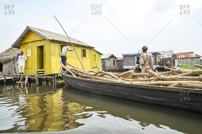 Ganvie, Benin, Africa; November 10, 2019; Ganvie is a lake village in Benin, Africa, lying in Lake Nokou�, near Cotonou. It is probably the largest lake village in Africa.  Stilt houses are raised on piles all over the lake. The village was created in the sixteenth or seventeenth centuries by the Tofinu people who took to the lake to avoid Fon warriors who were capturing slaves for sale to European traders. The village was added to the UNESCO World Heritage Tentative List on October 31, 1996 in the Cultural category.