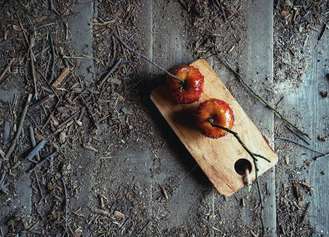 Red apples in caramel on wooden desk