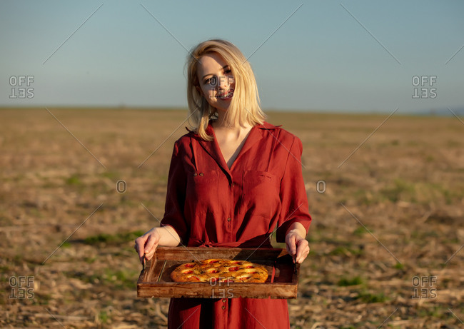 Woman hold Italian bread focaccia on a desk at outdoor