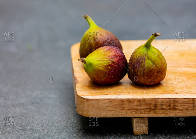 Fresh common figs on wooden desk