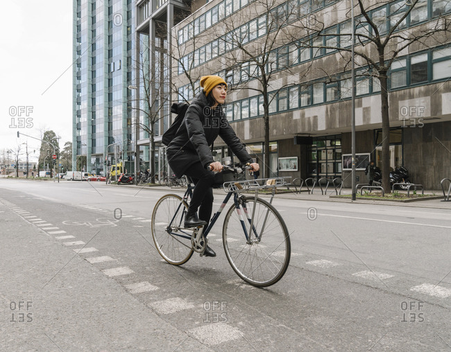 Woman riding bicycle in the city- Frankfurt- Germany