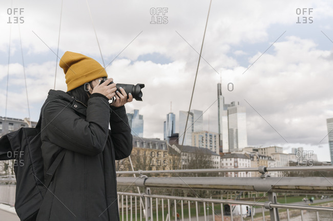 Tourist taking picture with a camera on a bridge- Frankfurt- Germany