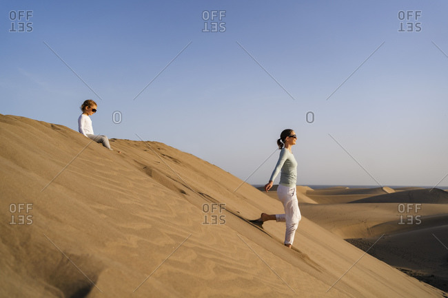 Mother and daughter in sand dunes- Gran Canaria- Spain