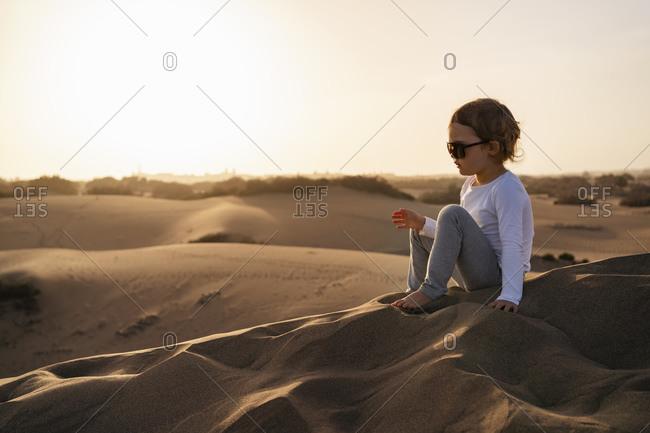 Girl sitting in sand dunes- Gran Canaria- Spain