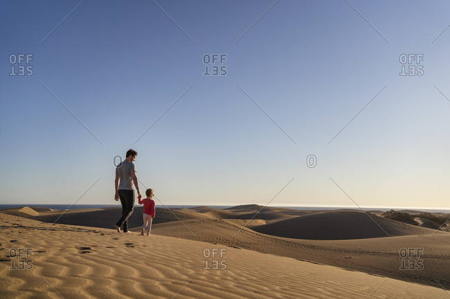 Father and daughter in sand dunes- Gran Canaria- Spain