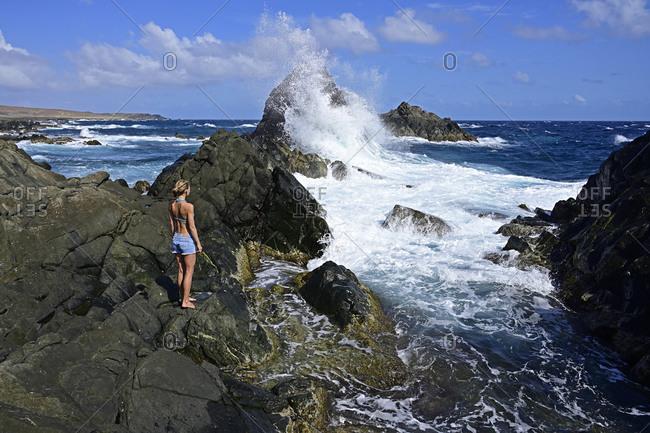 Woman standing at natural pool- Arikok National Park- Aruba- Antilles