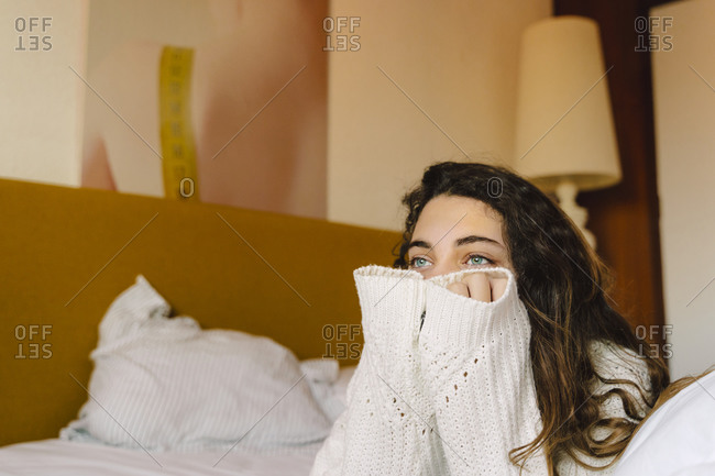 Portrait of girl on bed looking at distance