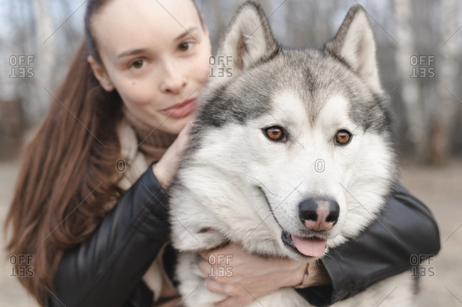 Portrait of husky hugged by owner