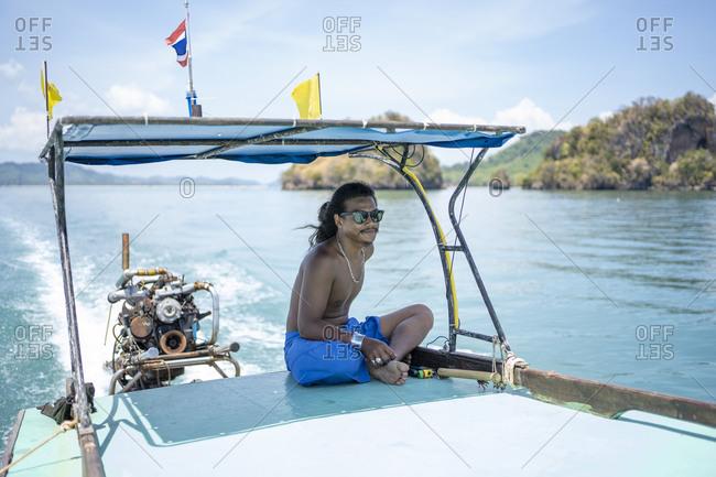 Young native man on a boat trip- Ko Yao Yai- Thailand