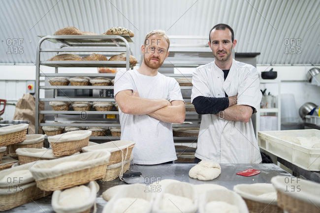 Portrait of two confident bakers in bakery