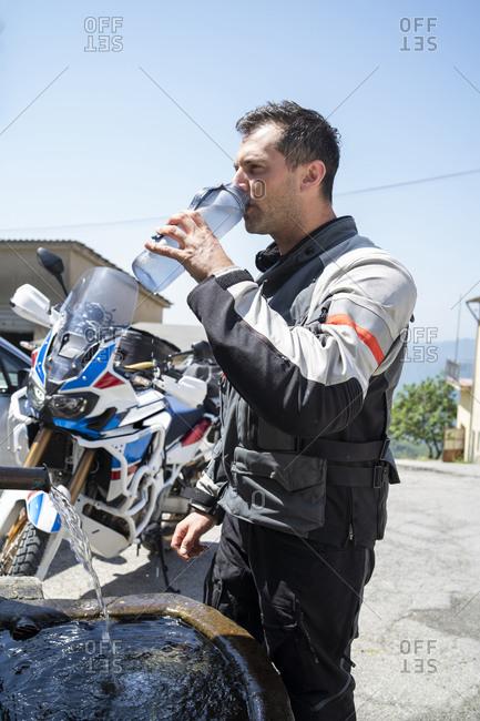 Motorcyclist on a trip having a cooling break