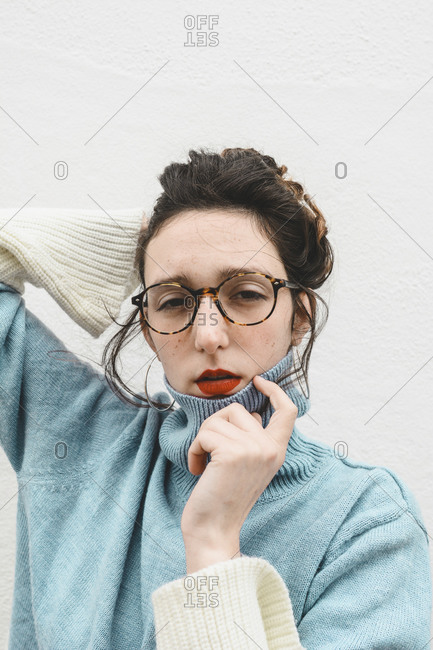 Portrait of young woman wearing glasses