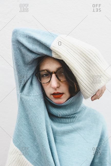 Portrait of young woman wearing turtleneck pullover