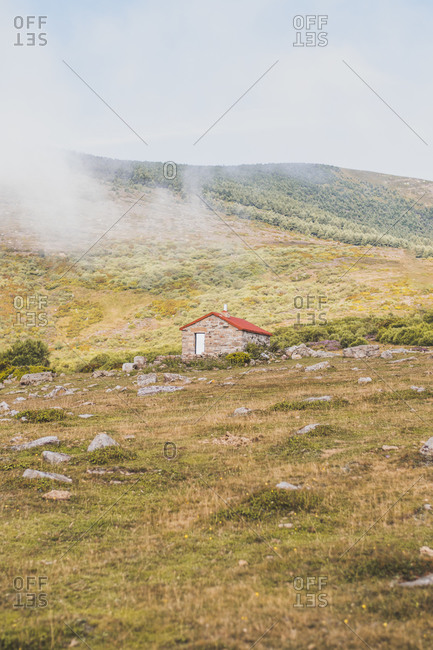Spain- Cantabria- Fog floating over secluded hut