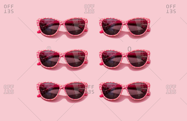 Pink retro sunglasses against pastel pink background