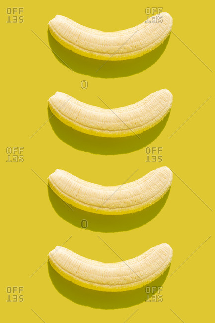3D illustration of peeled bananas on yellow background