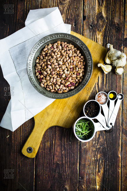 Bowl of pinto beans- salt and pepper- garlic- rosemary and olive oil