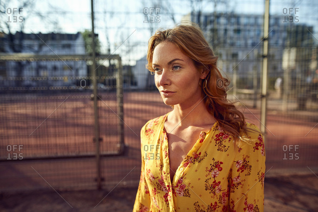 Portrait of red-haired woman at football ground