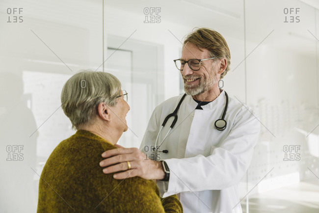Smiling doctor and senior patient in medical practice
