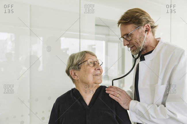 Doctor examining senior patient in medical practice