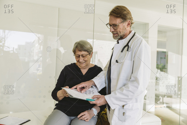 Doctor discussing test results of senior patient