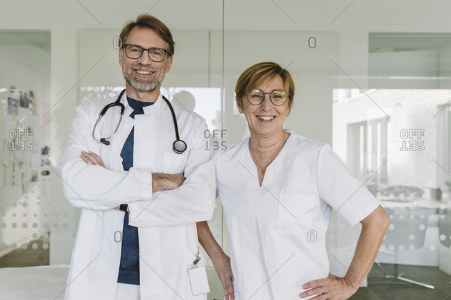 Portrait of confident doctor and assistant in medical practice