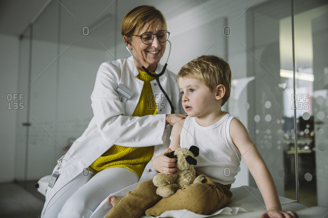 Doctor examining toddler boy with a stethoscope